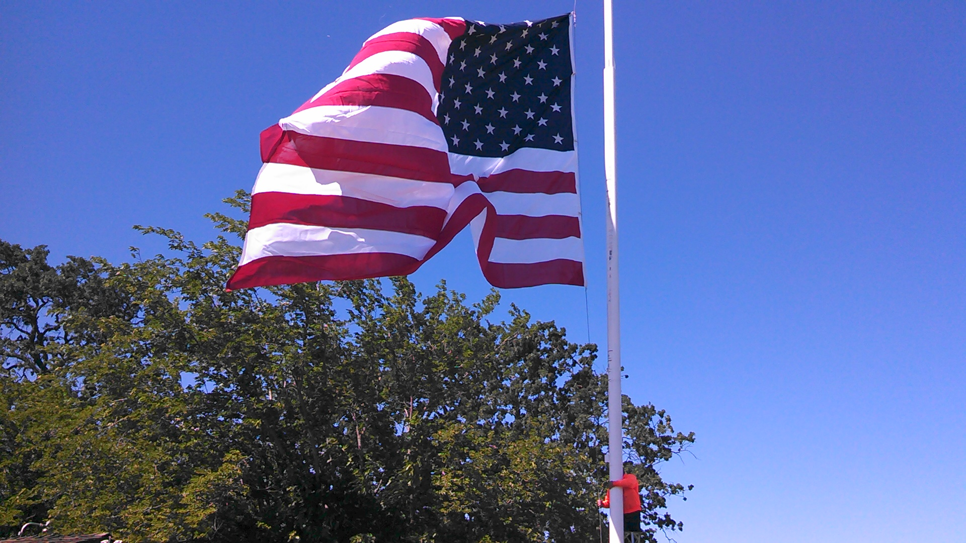 Photo of US Flag against the blue sky